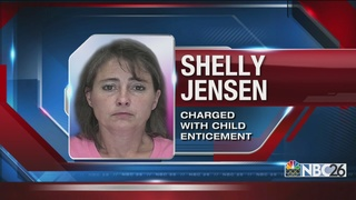 Teacher's aide charged with child enticement