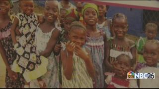 Volunteers dressing girls around the world