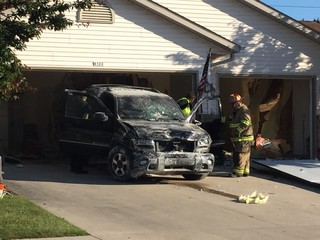 Driver injured after crashing into duplex