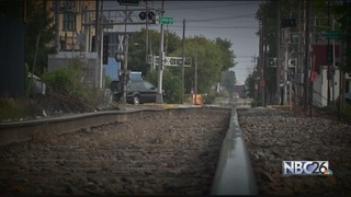 Man hit by train remains hospitalized