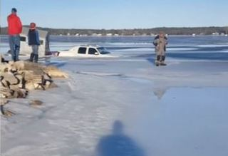 Truck caught on video falling through ice