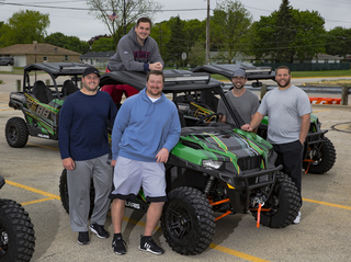 GALLERY: Aaron Rodgers gives ATVs to O-line