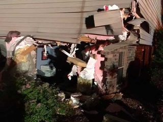 Pickup vs. house crash in Bellevue