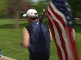'Flag man' inspires at Fox Cities Marathon